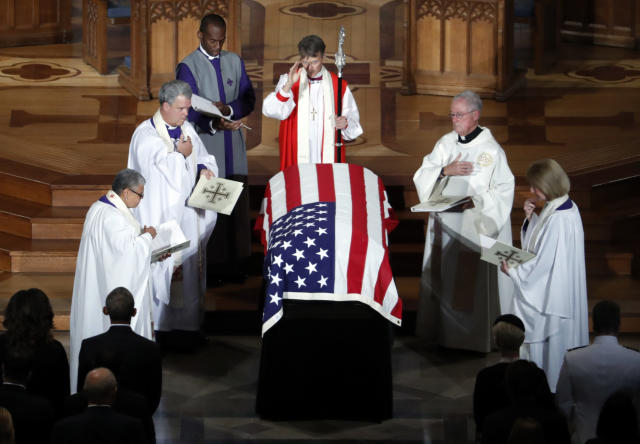 The casket of Sen. John McCain is blessed at the end of a memorial service at Washington National Cathedral on Saturday. (Photo: Pablo Martinez Monsivais/AP)
