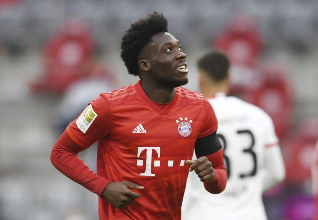 Bayern Munich's Alphonso Davies celebrates scoring Munich's fourth goal during the German Bundesliga soccer match between Bayern Munich and Eintracht Frankfurt in Munich, Germany, Saturday, May 23, 2020. (Andreas Gebert/pool via AP)