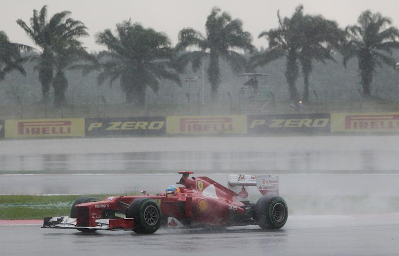 Ferrari Formula One driver Fernando Alonso of Spain steers his car during the Malaysian Formula One Grand Prix at Sepang, Malaysia, Sunday, March 25, 2012. (AP Photo/Achmad Ibrahim)
