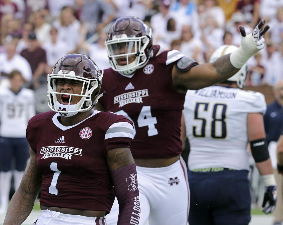 Mississippi State defensive tackle Jeffrey Simmons, No. 94 (rear), will not be invited to the NFL combine after a 2016 incident of violence against a woman. (AP)