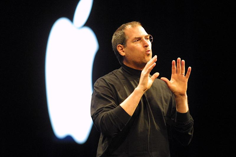 Steve Jobs wears an Issey Miyake black mock turtleneck at Apple's 2001 keynote address in San Francisco. (Photo: Alan Dejecacion via Getty Images)