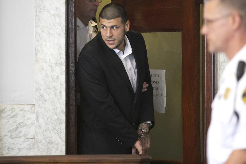 ATTLEBORO, MA - JULY 24: Aaron Hernandez entered the court room. Former New England Patriots tight end Aaron Hernandez appeared in Attleboro District Court in Attleboro, Mass. on Wednesday, July 24, 2013. (Photo by Yoon S. Byun/The Boston Globe via Getty Images)