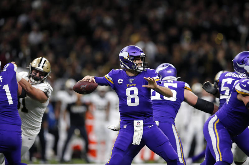 Minnesota Vikings quarterback Kirk Cousins (8) passes in the first half of an NFL wild-card playoff football game against the New Orleans Saints, Sunday, Jan. 5, 2020, in New Orleans. (AP Photo/Brett Duke)