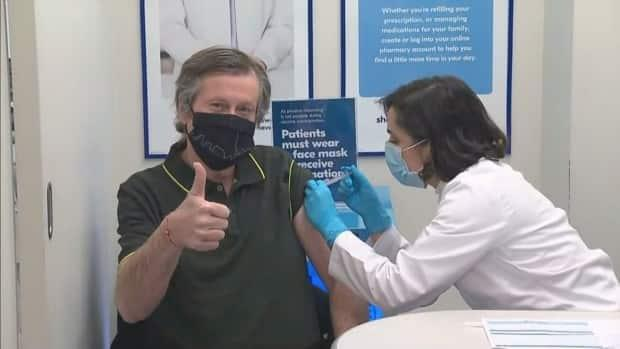 On Saturday, Mayor John Tory received a shot of the AstraZeneca vaccine at a pharmacy on Queen Street West. (CBC - image credit)