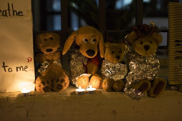 Stuffed toy animals wrapped in aluminum foil representing migrant children separated from their families are displayed in protest in front of the United States embassy in Guatemala City, June 20, 2018. Bowing to pressure from anxious allies, President Donald Trump abruptly reversed himself Wednesday and signed an executive order halting his administration's policy of separating children from their parents when they are detained illegally crossing the U.S. border. (AP Photo/Luis Soto)