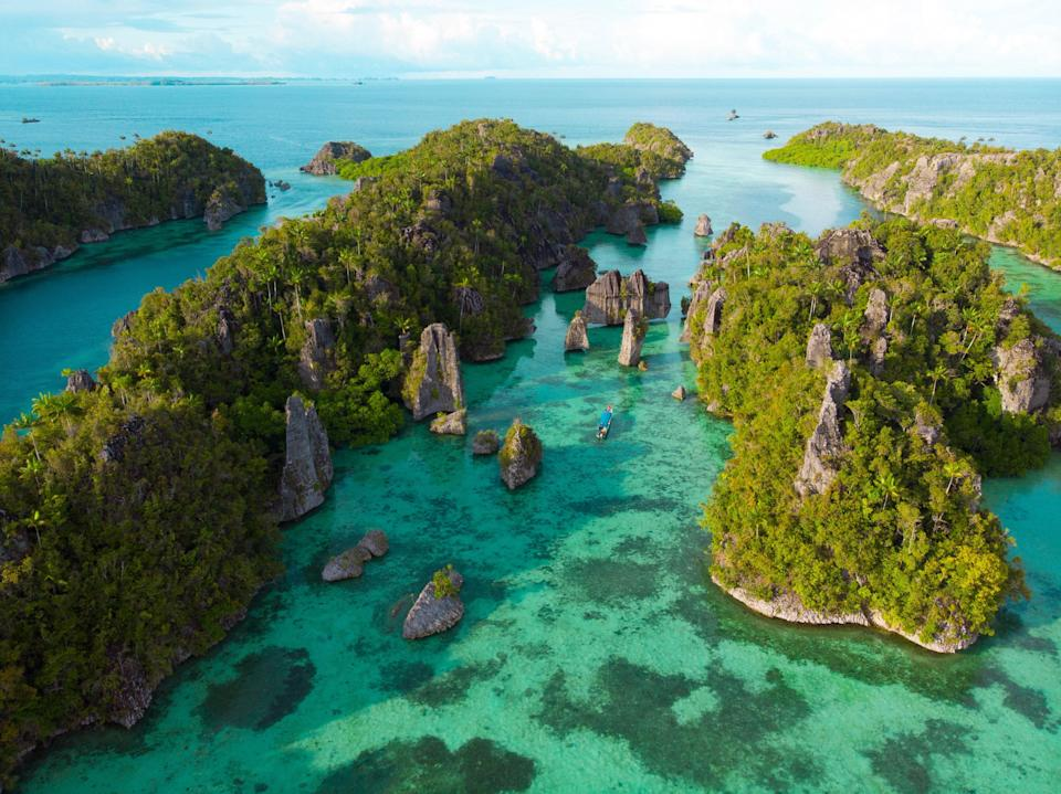"""Symbolized by two fish swimming in opposite directions, Pisces has an innate proclivity to water. White suggests the far-flung Indonesian archipelago of <a href=""""https://www.cntraveler.com/story/a-new-yacht-lets-divers-explore-raja-ampat-in-style?mbid=synd_yahoo_rss"""" rel=""""nofollow noopener"""" target=""""_blank"""" data-ylk=""""slk:Raja Ampat"""" class=""""link rapid-noclick-resp"""">Raja Ampat</a>. It takes effort to reach this remote corner of Southeast Asia—flying first to <a href=""""https://www.cntraveler.com/stories/2015-05-12/5-things-you-must-do-in-jakarta?mbid=synd_yahoo_rss"""" rel=""""nofollow noopener"""" target=""""_blank"""" data-ylk=""""slk:Jakarta"""" class=""""link rapid-noclick-resp"""">Jakarta</a>, then to Sorong, where most travelers hop on a liveaboard—but Pisces's determination pays dividends in the form of stunning coral reefs, sugary white beaches, dense emerald jungle, secluded caves, and prehistoric petroglyphs. Whatever discomfort must be endured along the way will be worth it for the fluid water sign. Says White, """"Deeply spiritual Pisces goes with the flow because they know there is a greater plan at work."""""""