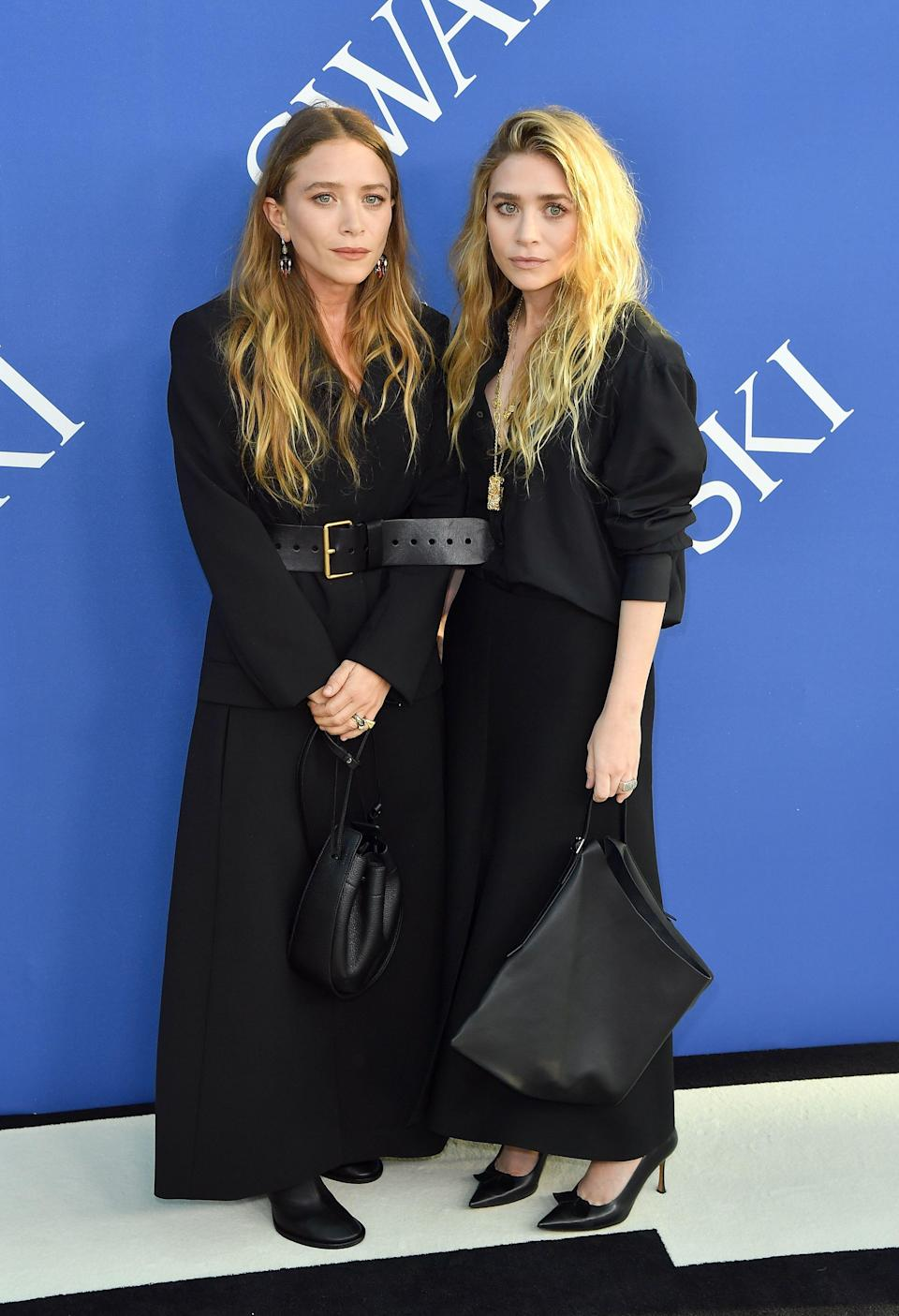<p>Name a more iconic duo. Mary-Kate and Ashley Olsen donned head-to-toe black and simultaneously proved that they're still on top of their fashion game by wearing their own label, The Row. <em>[Photo: Getty]</em> </p>