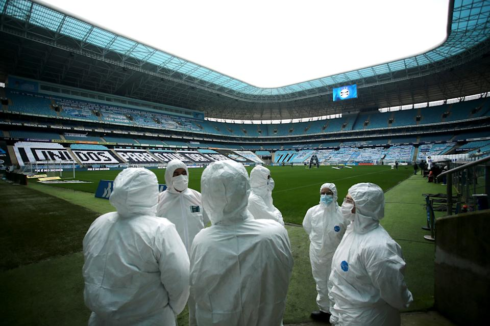 Soccer Football - Brasileiro Championship - Gremio v Fortaleza - Arena do Gremio, Porto Alegre, Brazil - September 13, 2020 General view of staff wearing personal protective equipment (PPE) inside the stadium before the match following the outbreak of the coronavirus disease (COVID-19) REUTERS/Diego Vara     TPX IMAGES OF THE DAY