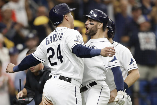 Tampa Bay Rays' Kevin Kiermaier, right, celebrates his 3-run home run in the second inning against the Houston Astros with Avisail Garcia (24) during Game 3 of a baseball American League Division Series, Monday, Oct. 7, 2019, in St. Petersburg, Fla. (AP Photo/Chris O'Meara)
