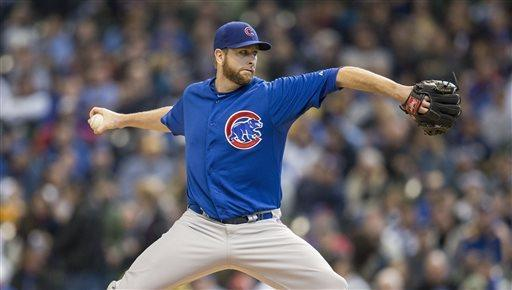 Chicago Cubs' Scott Feldman pitches to a Milwaukee Brewers batter during the first inning of a baseball game on Sunday, April 21, 2013, in Milwaukee. (AP Photo/Tom Lynn)