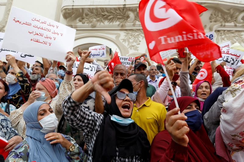 Opponents of Tunisia's President Kais Saied protest against what they call his coup on July 25, in Tunis