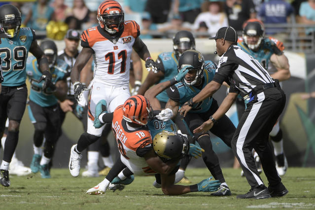 Cincinnati Bengals wide receiver A.J. Green (18) takes down Jacksonville Jaguars cornerback Jalen Ramsey (20) during a fight. (AP)