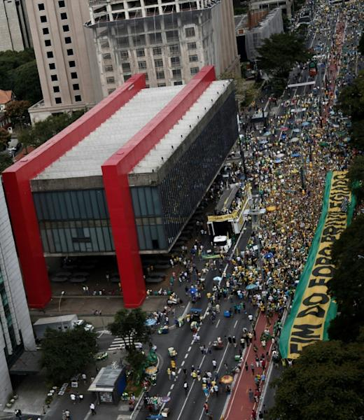 Demonstrators march along Paulista Avenue in Sao Paulo, Brazil, on March 26, 2017 during a nationwide protest against political corruption