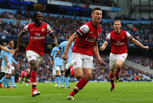 MANCHESTER, ENGLAND - SEPTEMBER 23: Laurent Koscielny of Arsenal celebrates after scoring their first goal during the Barclays Premier League match between Manchester City and Arsenal at Etihad Stadium on September 23, 2012 in Manchester, England. (Photo by Alex Livesey/Getty Images)