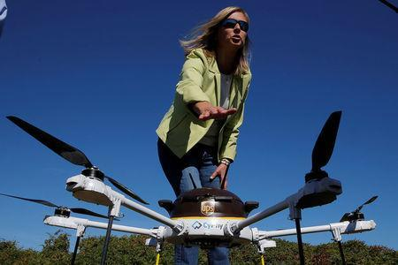 Helen Greiner, founder of CyPhy Works, talks about the CyPhy Works drone which carried a UPS package to Children's Island off the coast of Beverly, Massachusetts. REUTERS/Brian Snyder