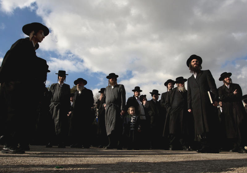 FILE - in this Sunday Jan. 15, 2012 file photo, ultra-Orthodox Jews participate in a protest in Jerusalem. A cultural war has erupted between Israel's rising political star and his ultra-Orthodox archrivals: newly minted Finance Minister Yair Lapid, hugely popular for opposing the longstanding preferential treatment enjoyed by the growing religious minority, is moving swiftly to slash state handouts to large families, compel lifelong seminary students to work and remove funding for schools that don't teach math, science and English. (AP Photo/Sebastian Scheiner, File)