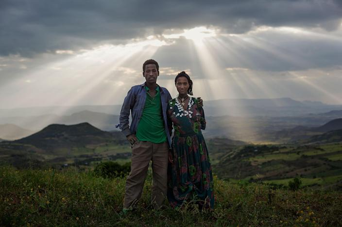 <p>Abaynesh and Tadesse pose in the back of their home after collecting lentils in Gindero, Amhara, Ethiopia in October 2016. The state where they come from, Amhara, has the lowest median age for a first marriage (14.7 years). (Photo: José Colón/MeMo) </p>