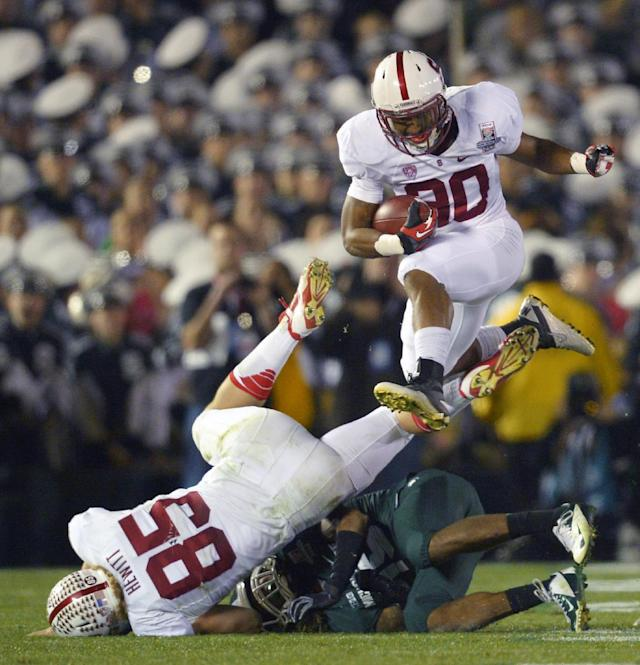 Stanford running back Ricky Seale jumps over Stanford fullback Ryan Hewitt and a Michigan State defender during the second half of the Rose Bowl NCAA college football game on Wednesday, Jan. 1, 2014, in Pasadena, Calif. Michigan State won 24-20. (AP Photo/Mark J. Terrill)