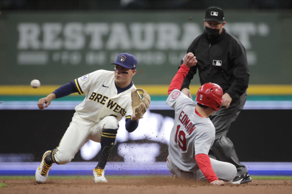 St. Louis Cardinals' Tommy Edman (19) steals second base as Milwaukee Brewers' Luis Urias waits for the throw during the third inning of a baseball game Tuesday, May 11, 2021, in Milwaukee. (AP Photo/Aaron Gash)