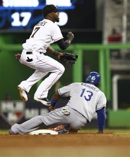 Los Angeles Dodgers runner Hanley Ramirez (13) is forced out at second by Miami Marlins shortstop Jose Reyes as he completes the third inning double play with James Loney out at first during a baseball game in Miami, Saturday, Aug. 11, 2012. (AP Photo/J Pat Carter)