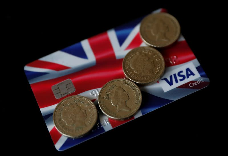 British pound coins are seen on top of a Union Jack themed Visa credit card in this photo illustration taken in Manchester, Britain.