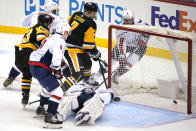 Pittsburgh Penguins' Colton Sceviour (7) puts the puck behind Washington Capitals goaltender Craig Anderson for a goal during the first period of an NHL hockey game in Pittsburgh, Tuesday, Jan. 19, 2021. (AP Photo/Gene J. Puskar)