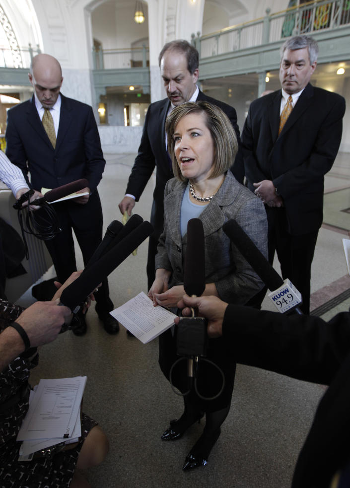 Kristen Waggoner, an attorney representing Ralph's Thriftway in Olympia, Wash., and two licensed Washington pharmacists, the plaintiffs in a court case to decide if Washington state could force pharmacies to sell Plan B or other emergency contraceptives, talks to reporters, Wednesday, Feb. 22, 2012, in Tacoma, Wash., after a federal judge ruled that Washington state may not force pharmacies to sell the contraceptives. (AP Photo/Ted S. Warren)