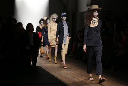 Models present creations from the Vivienne Westwood Red Label Spring/Summer 2014 collection during London Fashion Week