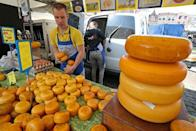 A seller arranges product on a table at the cheese market in Gouda, Netherlands April 18, 2019. REUTERS/Yves Herman