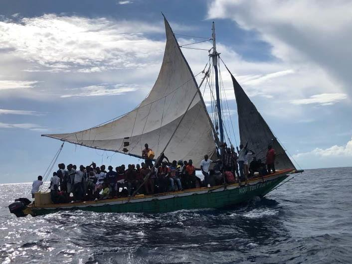 Migrants aboard a 35-foot sailing vessel are interdicted by a U.S. Coast Guard crew approximately 12 miles east of Biscayne Bay off Florida on Sept. 16.