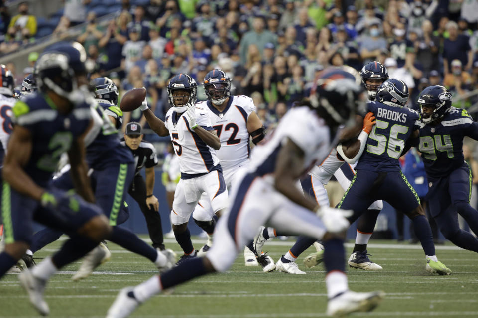 Denver Broncos quarterback Teddy Bridgewater (5) looks for a receiver during the first half of an NFL preseason football game against the Seattle Seahawks on Saturday, Aug. 21, 2021, in Seattle. (AP Photo/Jason Redmond)