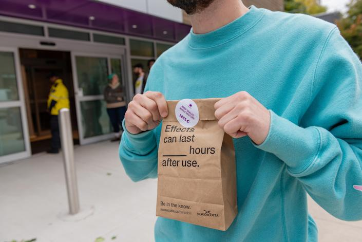 <p>A customer displays a sealed bag containing legally purchased cannabis products outside of a Nova Scotia Liquor Corp. (NSLC) store in Halifax, Nova Scotia, Canada, on Wednesday, Oct. 17, 2018. (Photo: Dean Casavechia/Bloomberg via Getty Images) </p>