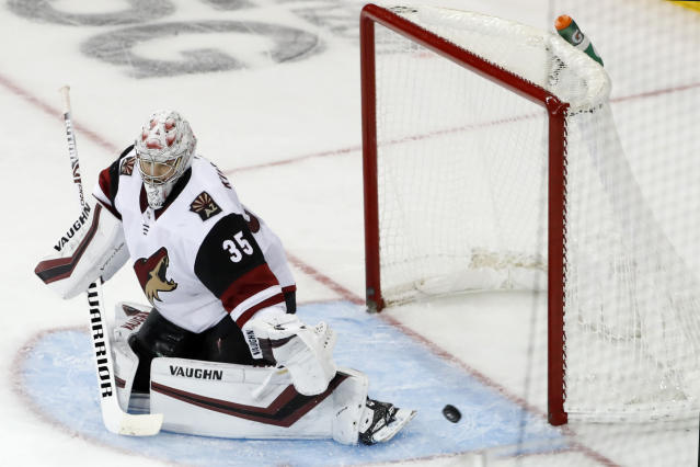 Arizona Coyotes goaltender Darcy Kuemper (35) deflects the puck during the third period of the team's NHL hockey game against the New York Rangers, Tuesday, Oct. 22, 2019, in New York. (AP Photo/Kathy Willens)
