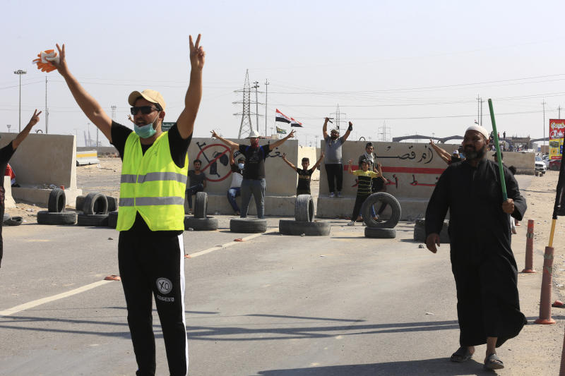 Anti-government protesters block the port of Umm Qasr a day after clashes between security forces and protesters, in Basra, Iraq, Sunday, Nov. 3, 2019. (AP Photo/Nabil al-Jourani)