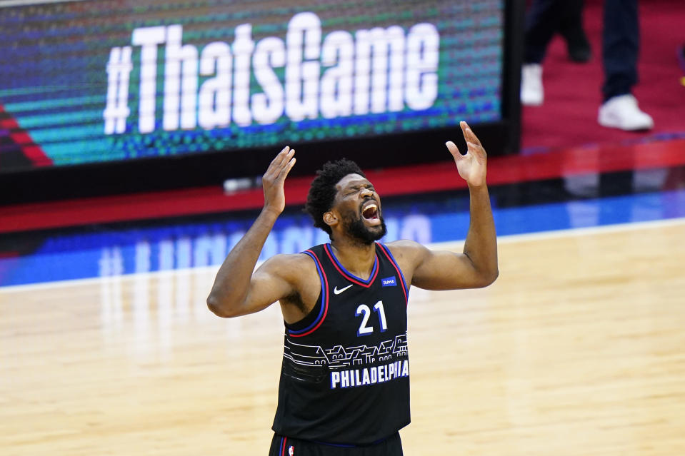 Philadelphia 76ers' Joel Embiid reacts after making a shot during the second half of Game 2 in a first-round NBA basketball playoff series against the Washington Wizards, Wednesday, May 26, 2021, in Philadelphia. (AP Photo/Matt Slocum)