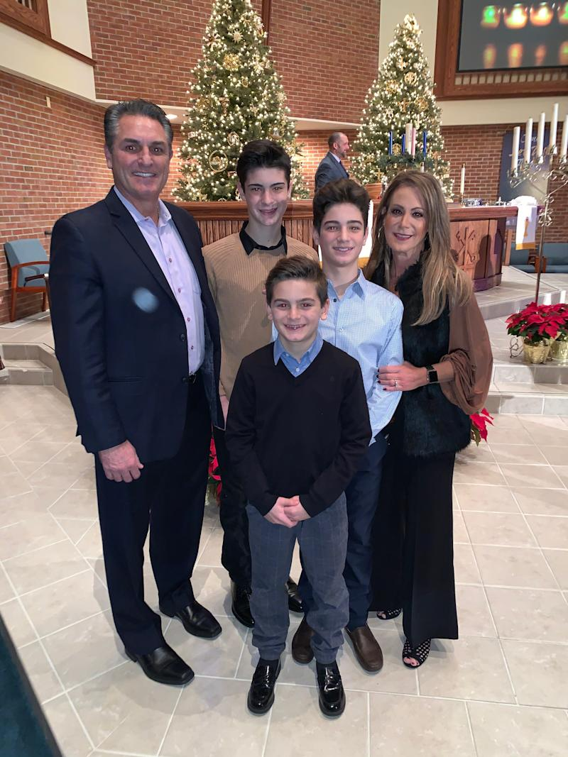 The Carroll family – Brian and his wife, Angie, and their sons, back to front, Benny, Dominic and Sammy – was reeling when Brian was fired in January 2019.