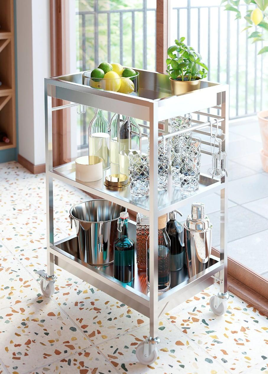 "<p>Store cocktail basics, cooking supplies, and whatever else you need on the <a href=""https://www.popsugar.com/buy/Kungsfors%20Kitchen%20Cart-447002?p_name=Kungsfors%20Kitchen%20Cart&retailer=ikea.com&price=149&evar1=casa%3Aus&evar9=46151613&evar98=https%3A%2F%2Fwww.popsugar.com%2Fhome%2Fphoto-gallery%2F46151613%2Fimage%2F46152191%2FKungsfors-Kitchen-Cart&list1=shopping%2Cikea%2Corganization%2Ckitchens%2Chome%20shopping&prop13=api&pdata=1"" rel=""nofollow noopener"" target=""_blank"" data-ylk=""slk:Kungsfors Kitchen Cart"" class=""link rapid-noclick-resp"">Kungsfors Kitchen Cart</a> ($149). The beautiful finish allows it to be useful for not only storage, but also as a piece of kitchen decor.</p>"