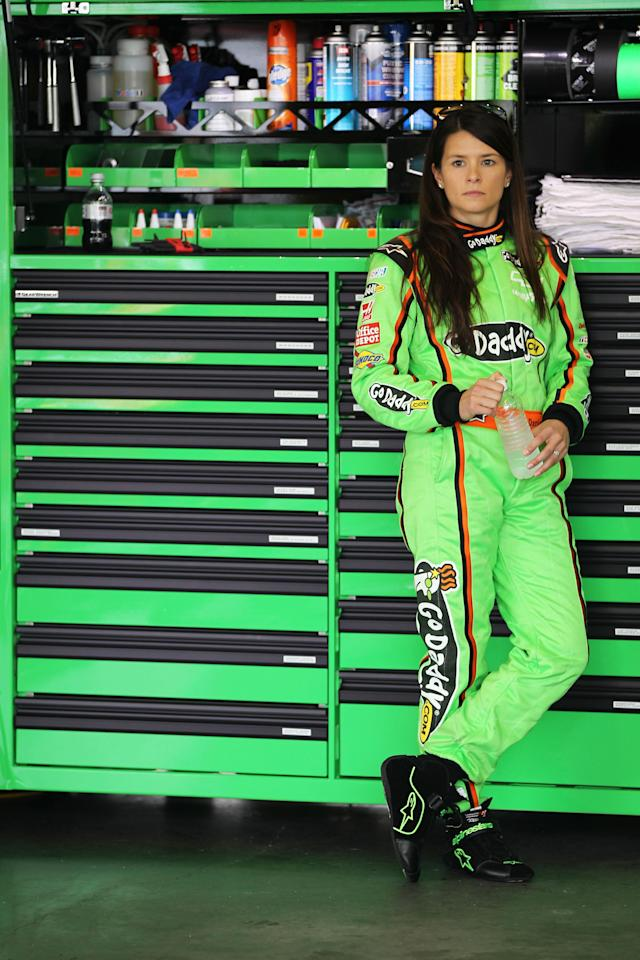 DAYTONA BEACH, FL - FEBRUARY 18: Danica Patrick, driver of the #10 GoDaddy.com Chevrolet, stands in the garage during practice for the NASCAR Sprint Cup Series Daytona 500 at Daytona International Speedway on February 18, 2012 in Daytona Beach, Florida. (Photo by Jamie Squire/Getty Images)