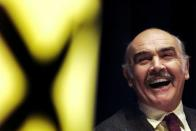 FILE PHOTO: Actor Sean Connery laughs as he listens to a speech by Alex Salmond at a Scottish National Party rally at the Edinburgh International conference centre