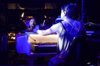 """A pianist rehearses at The Piano Works club in Farringdon, London, Friday, July 16, 2021, ahead of its reopening as part of the relaxation of COVID-19 restrictions. Thousands of young people plan to dance the night away at """"Freedom Day"""" parties as the clock strikes midnight Monday, when almost all coronavirus restrictions in England are due to be scrapped. Nightclubs can open fully and are not required to use vaccine passports. (AP Photo/Alberto Pezzali)"""