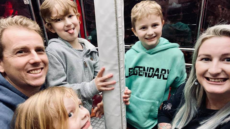 Luke (Left) and Angie Mansey (right) with their three children