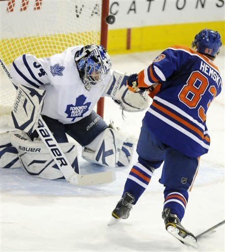 Edmonton Oilers' Ales Hemsky, right, hits the post on a shot against Toronto Maple Leafs goalie James Reimer during the second period of an NHL hockey game Wednesday, Feb 15, 2012, in Edmonton, Alberta. (AP Photo/The Canadian Press, John Ulan)
