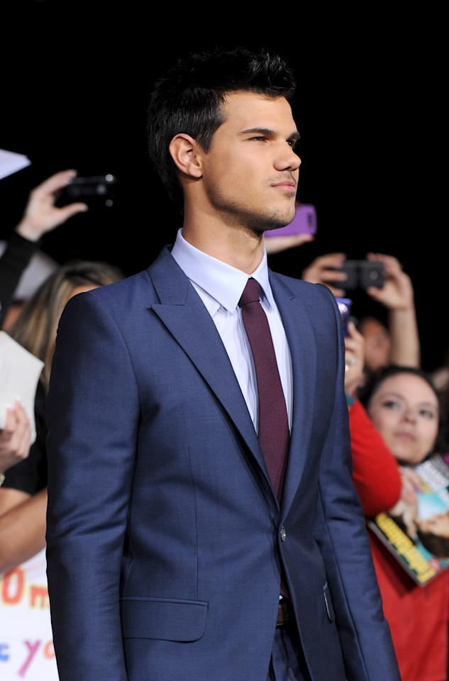 "LOS ANGELES, CA - NOVEMBER 14:  Actor Taylor Lautner arrives at the premiere of Summit Entertainment's ""The Twilight Saga: Breaking Dawn - Part 1"" at Nokia Theatre L.A. Live on November 14, 2011 in Los Angeles, California.  (Photo by Kevin Winter/Getty Images)"