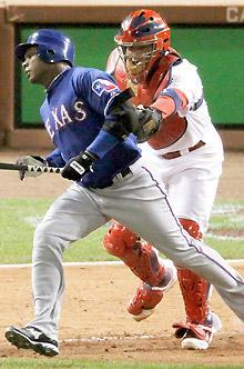 Cardinals catcher Yadier Molina tags out the Rangers' Esteban German after German struck out swinging and the ball was dropped during the seventh inning