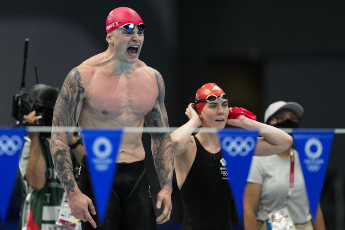 Adam Peaty celebrates winning the gold medal in the mixed 4x100-meter medley relay final at the 2020 Summer Olympics, Saturday, July 31, 2021, in Tokyo, Japan. (AP Photo/Jae C. Hong)
