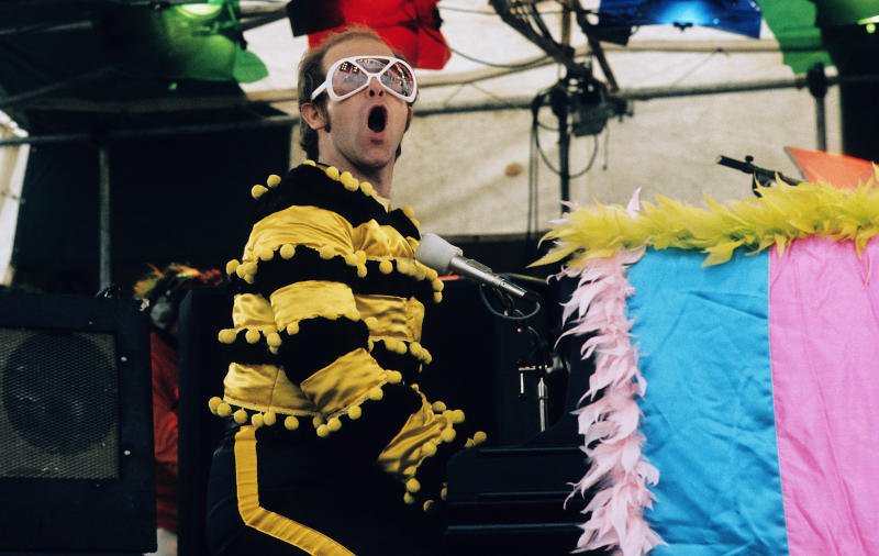 Elton John performs at an open-air concert in May 1974 in Watford, England. (Getty Images)