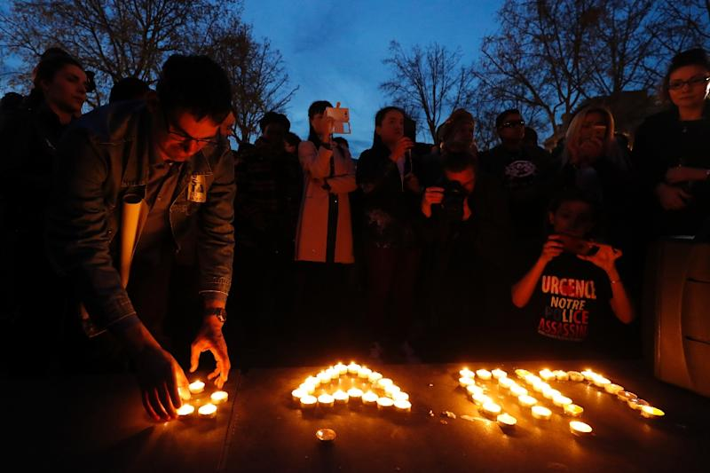 People light candles during a demonstration for justice on the Place de la Republique on March 30, 2017 following the death of Chinese Liu Shaoyo during a police intervention (AFP Photo/FRANCOIS GUILLOT)