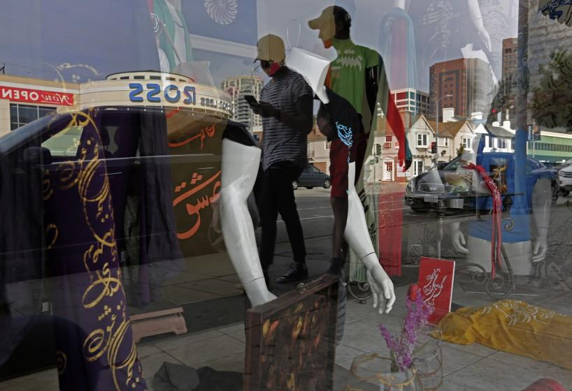 LOS ANGELES, CA - Jan. 20, 2016: People are reflected in a storefront as they walk down Westwood Blvd., in Persian Square, in Los Angeles. (Photo by Katie Falkenberg / Los Angeles Times)