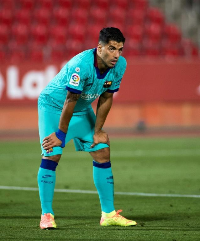 Luis Suarez's trademark look, resting with his hands on his thighs. The Uruguayan made his comeback from a knee injury in Barcelona's win in Mallorca (AFP Photo/JAIME REINA)