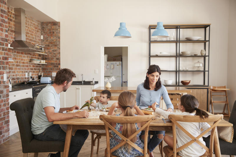 Less than a third of families still eat dinner together [Photo: Getty]